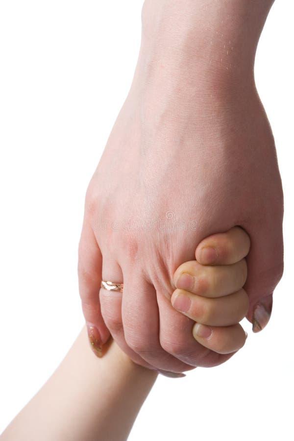 Main de chéri dans le bras de mère images stock