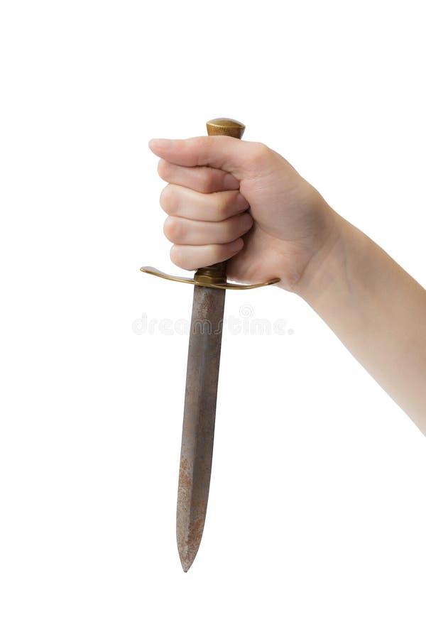 Main de femme avec le vieux poignard sur le fond blanc image libre de droits
