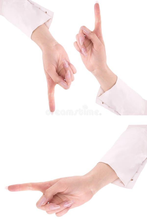 Main de femme d'affaires dirigeant, vers le bas, gauche, sur un backgroun blanc photo stock