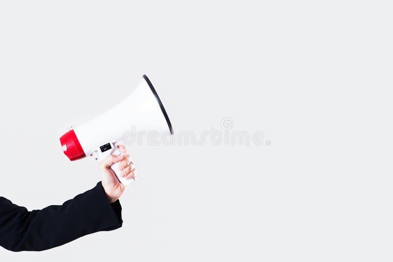 Main de femme d'affaires tenant un mégaphone image libre de droits