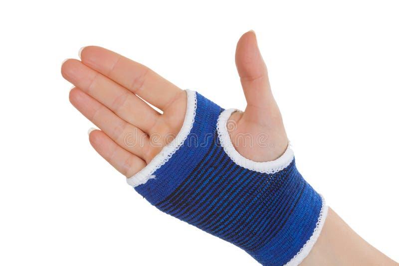 Main de femme enveloppée dans l'appui de paume de bandage photo stock