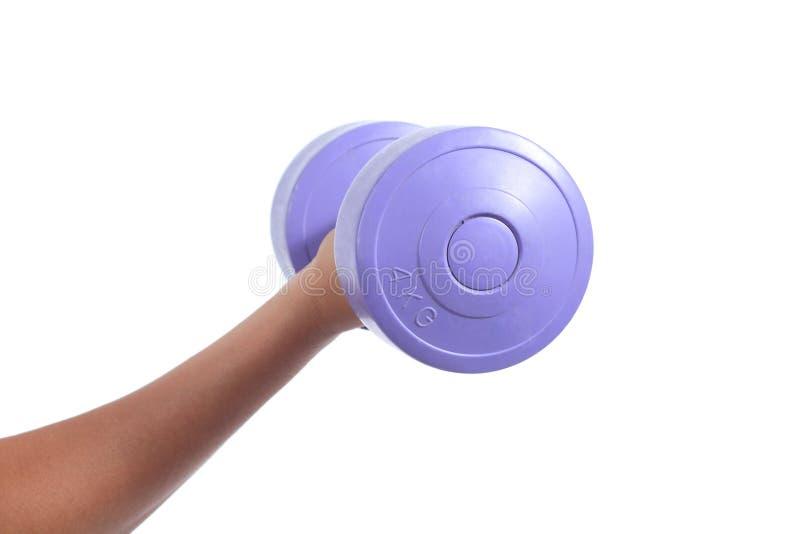 Main de femme faisant des poids avec une haltère photographie stock