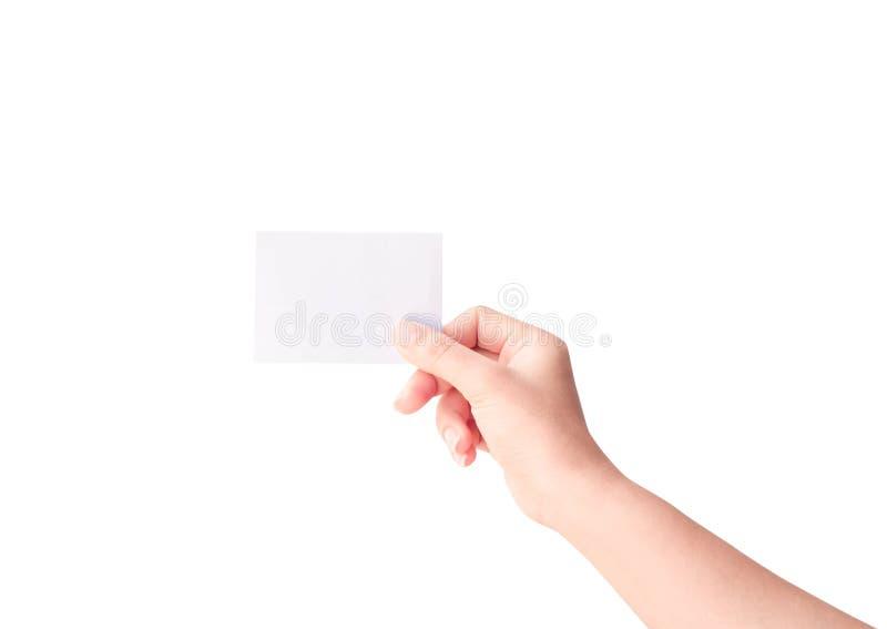 Main de femme jugeant le papier d'isolement sur le fond blanc image libre de droits