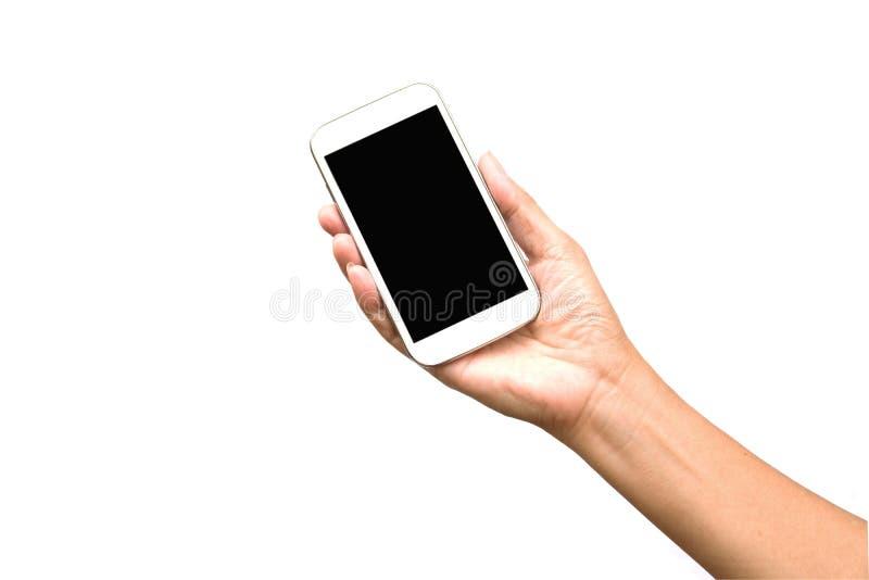 Main de femme jugeant le téléphone intelligent d'isolement sur le blanc photographie stock