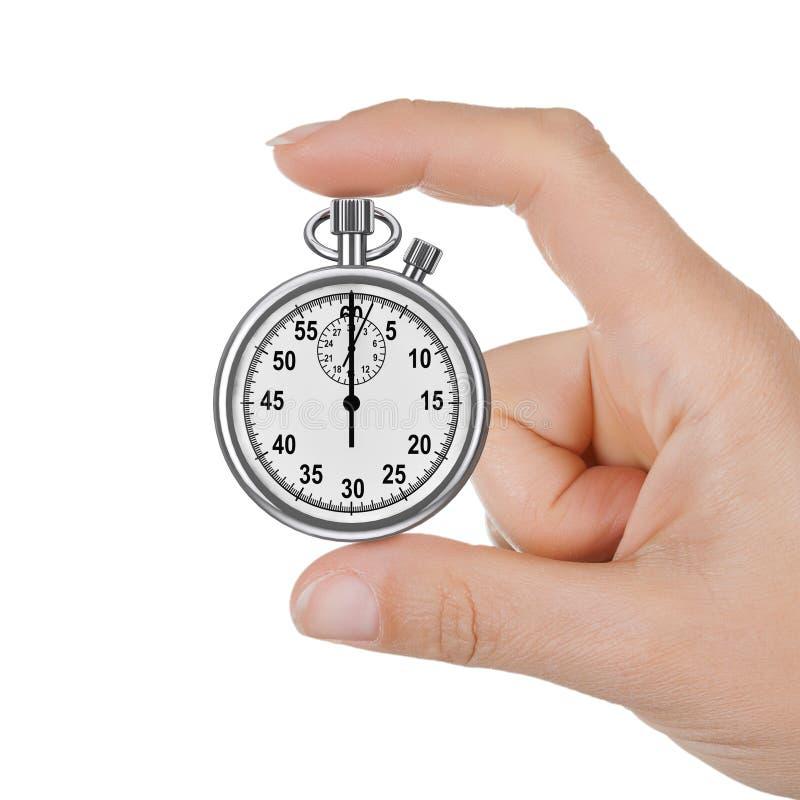 Main de femme de plan rapproché avec un chronomètre photographie stock