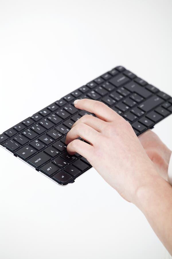 Main de femme sur le clavier photos libres de droits