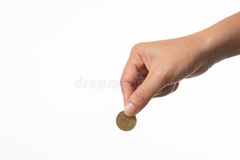 Main de femme tenant la pièce de monnaie sur le rassemblement photo stock
