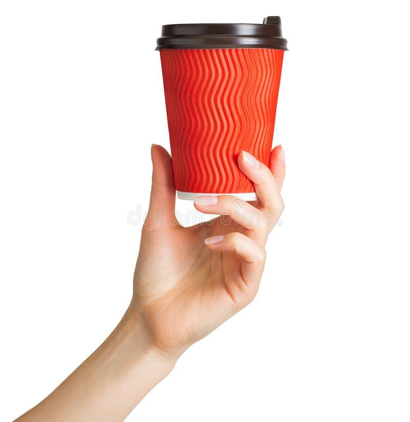 Main de femme tenant la tasse de boissons de papier de café photo stock