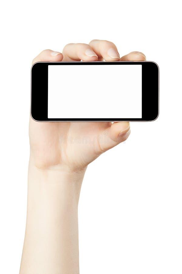 Main de femme tenant le smartphone horizontal photos stock