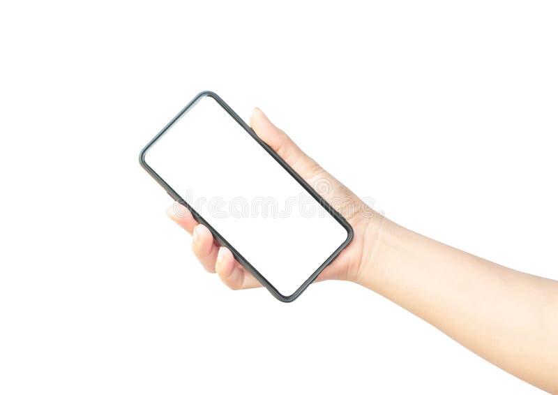 Main de femme tenant le smartphone noir photographie stock libre de droits