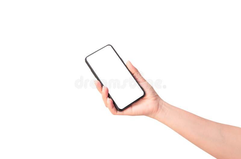 Main de femme tenant le smartphone noir images libres de droits