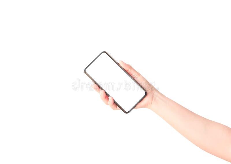 Main de femme tenant le smartphone noir photo stock