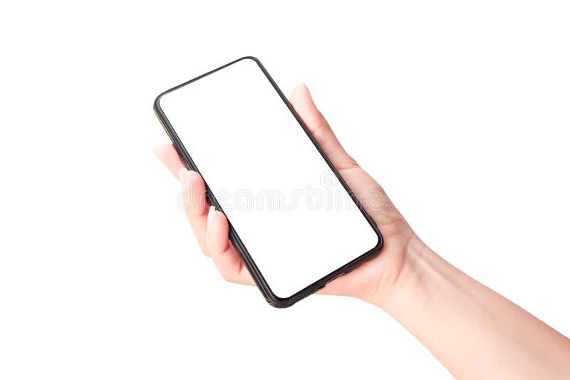 Main de femme tenant le smartphone noir photographie stock