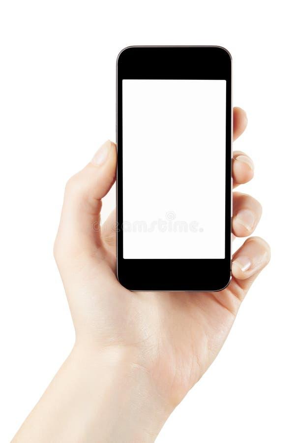 Main de femme tenant le smartphone sur le blanc images stock