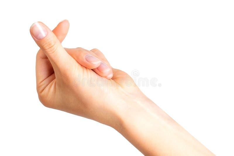Main de femme tenant quelque chose avec deux doigts photos stock