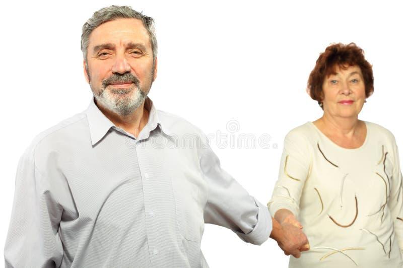 Main de prise d'homme aîné de femme image stock