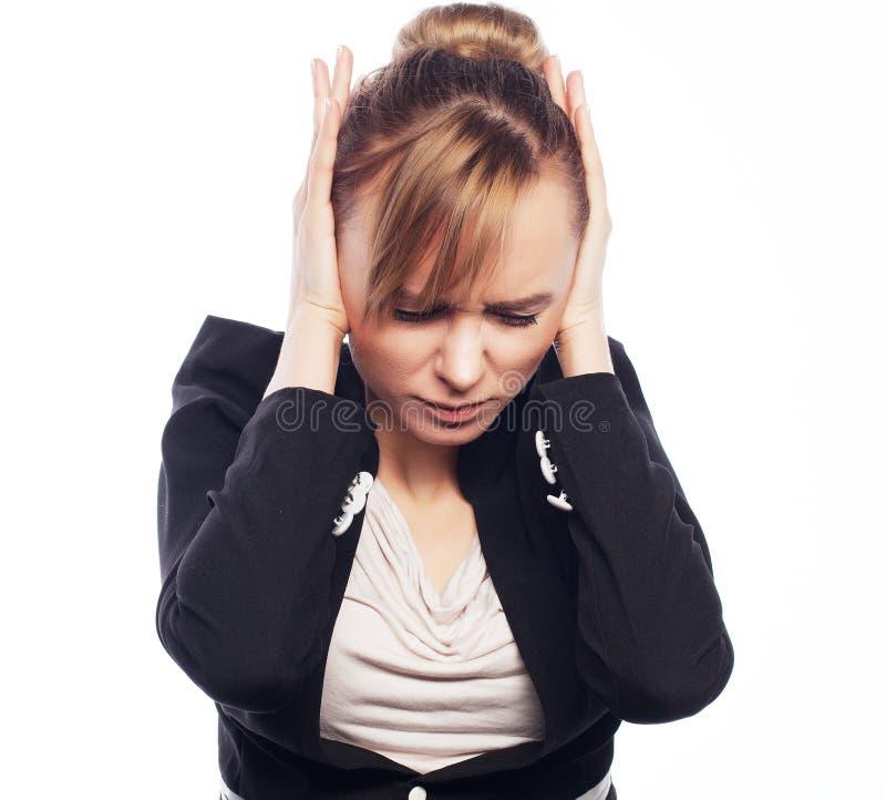 Main de prise terrifiée par femme d'affaires sur la tête photos libres de droits