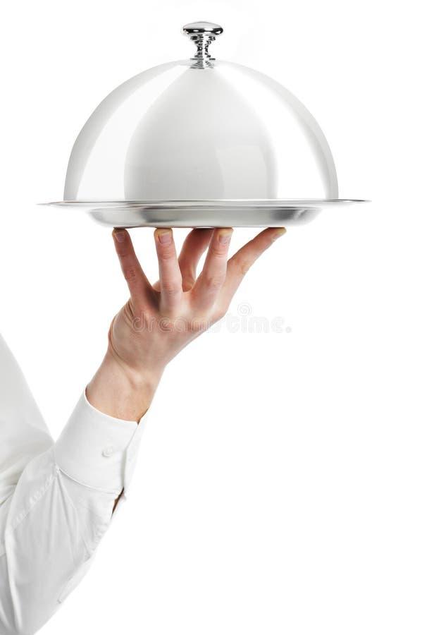 Main de serveur avec le couvercle de cloche photographie stock