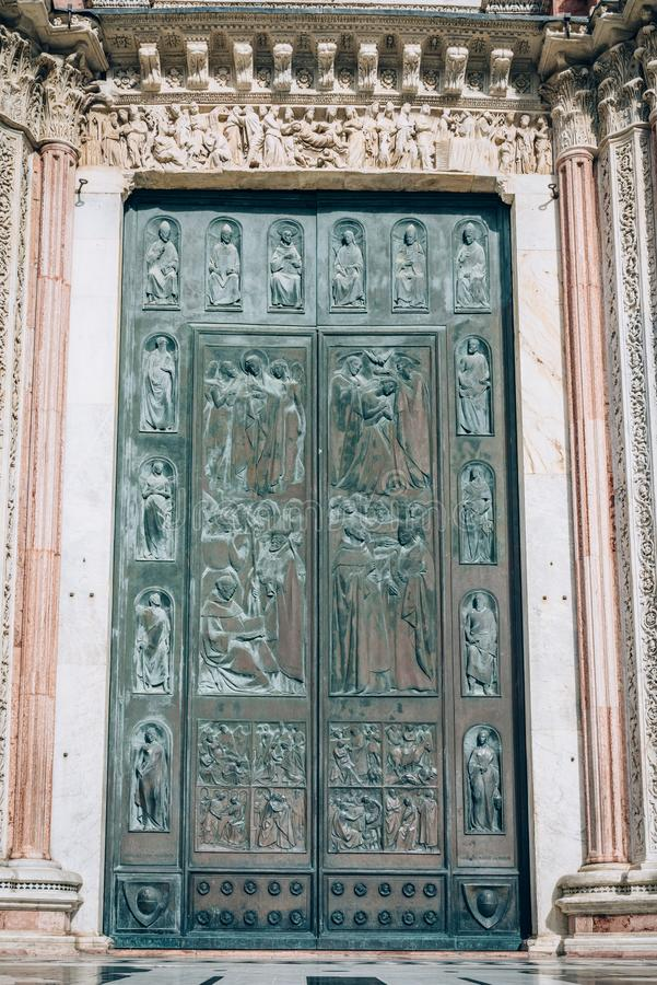 Duomo Cathedral door in Siena, Tuscany, Italy stock image