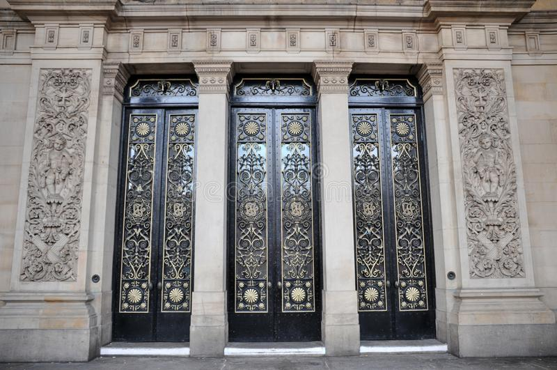The main doors of leeds town hall with ornate columns and carving. The main doors of leeds town hall with ornate columns and details royalty free stock photography