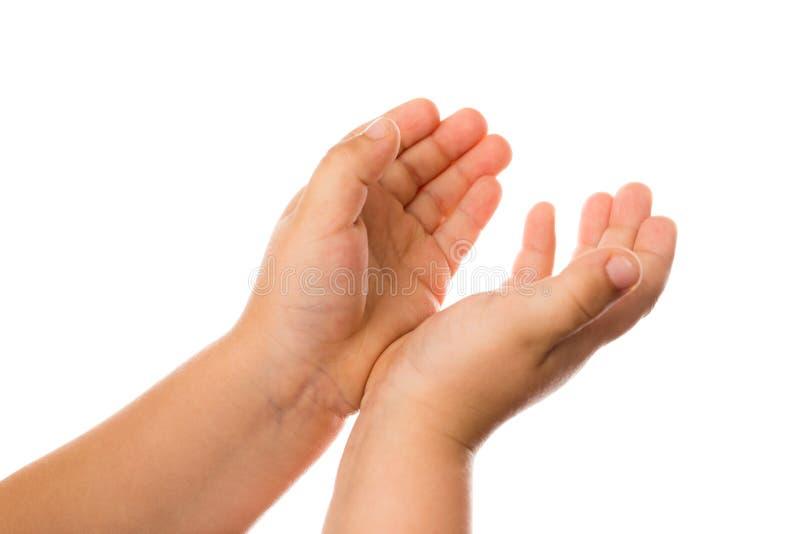 Main du ` s de deux enfants sur un fond blanc photos stock