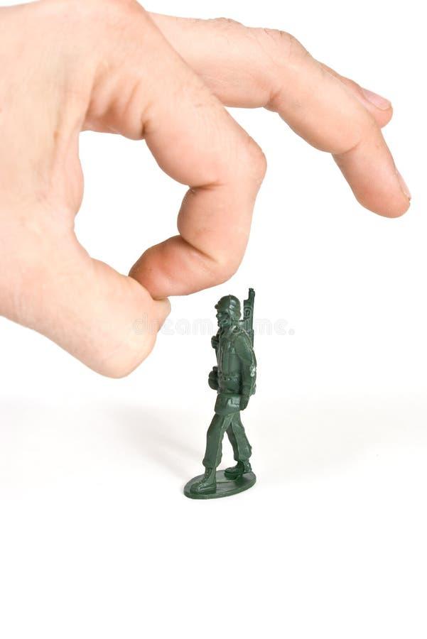 Main du soldat de jouet W photographie stock libre de droits