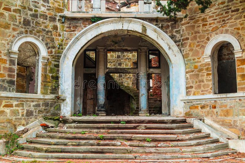 Main entrance of abandoned mansion Dacha Kvitko, Sochi, Russia. The main entrance with stairs of the abandoned old mansion called Dacha Kvitko, Sochi, Russia royalty free stock photography
