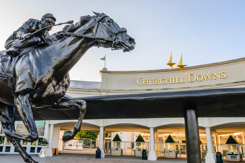Main Entrance to Churchill Downs. LOUISVILLE, KENTUCKY, USA - MAY 15, 2016: Entrance to Churchill Downs featuring a statue of 2006 Kentucky Derby Champion royalty free stock photo