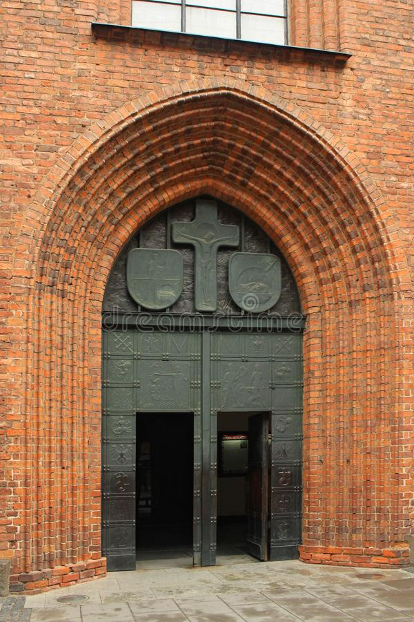 WARSAW, POLAND - MAY 12, 2012: Main entrance to gothic St. John`s Archcathedral church in historical part of Warsaw. royalty free stock images