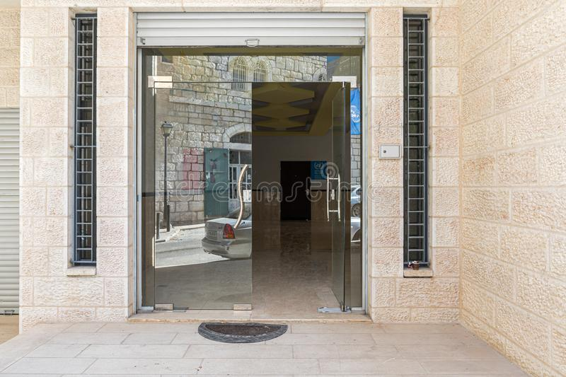 The main entrance to the office UNRWA - department of microfinance - Bethlehem branch in Bethlehem in Palestine. Jerusalem, Israel, December 28, 2018 : The main stock image