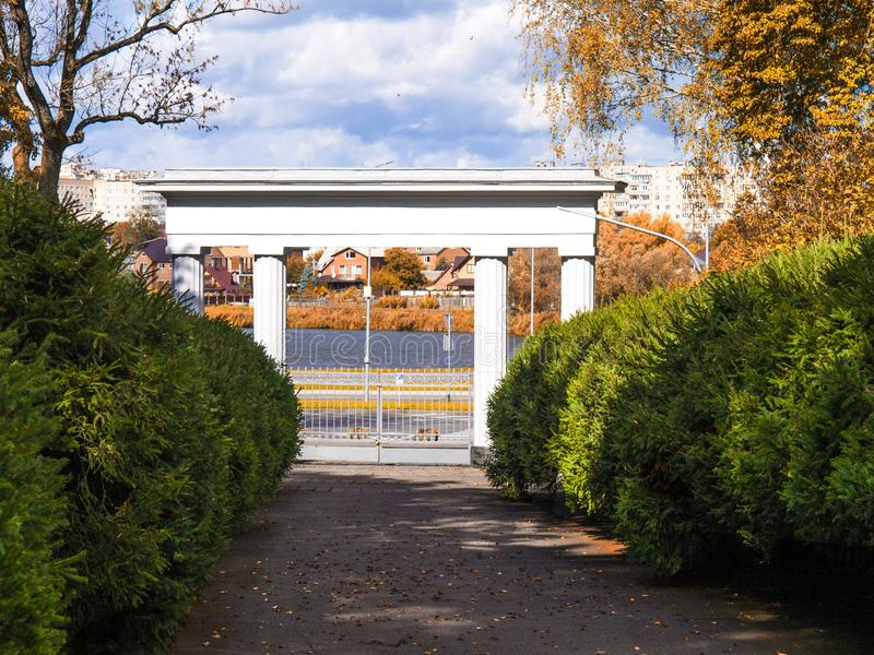 The main entrance to the park. Green Spruce Alley royalty free stock photography