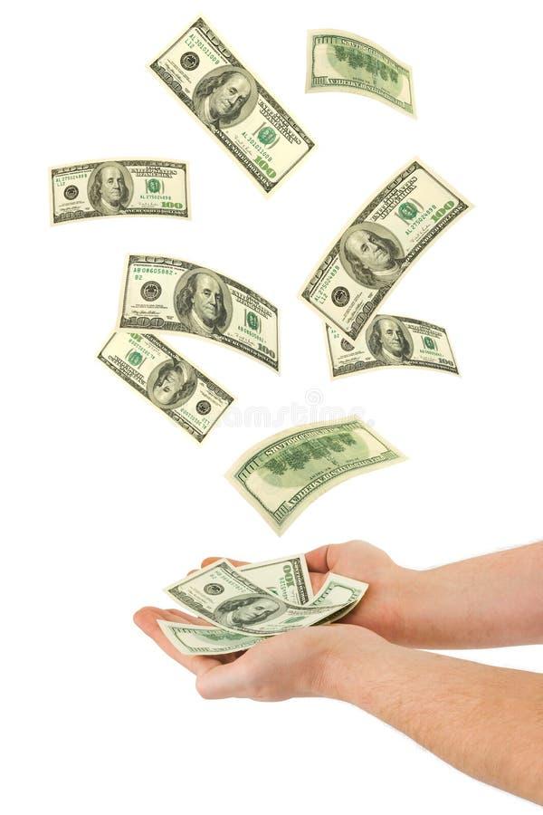 Main et argent en baisse photographie stock libre de droits
