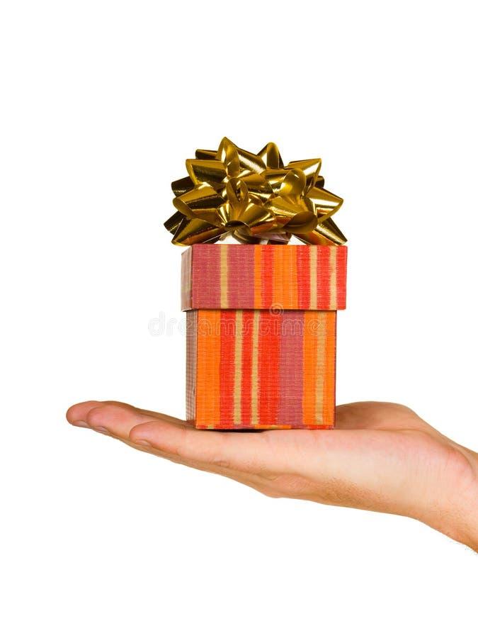 Main et cadeau image libre de droits