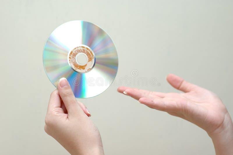 Main et dvd photos stock