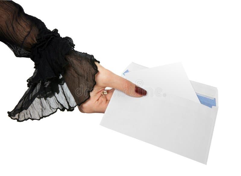 Main et enveloppe photographie stock