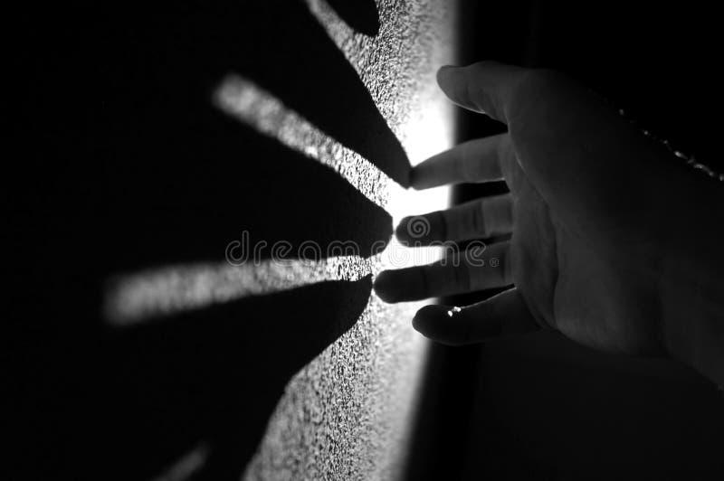 Main et lumière image stock