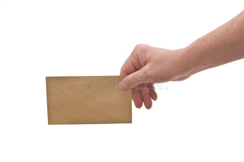 Main et petite enveloppe photographie stock