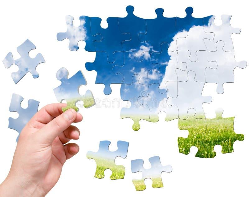Main et puzzle image libre de droits