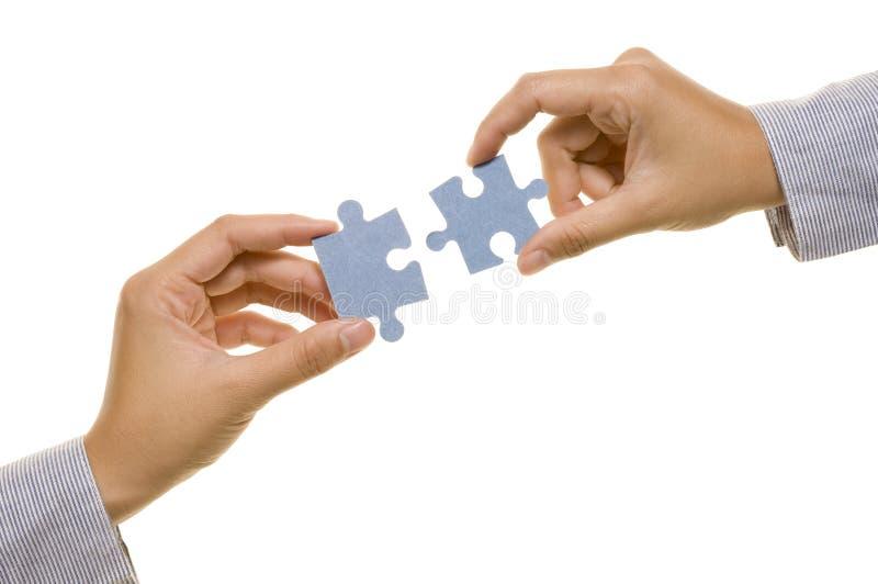 Main et puzzle photo libre de droits