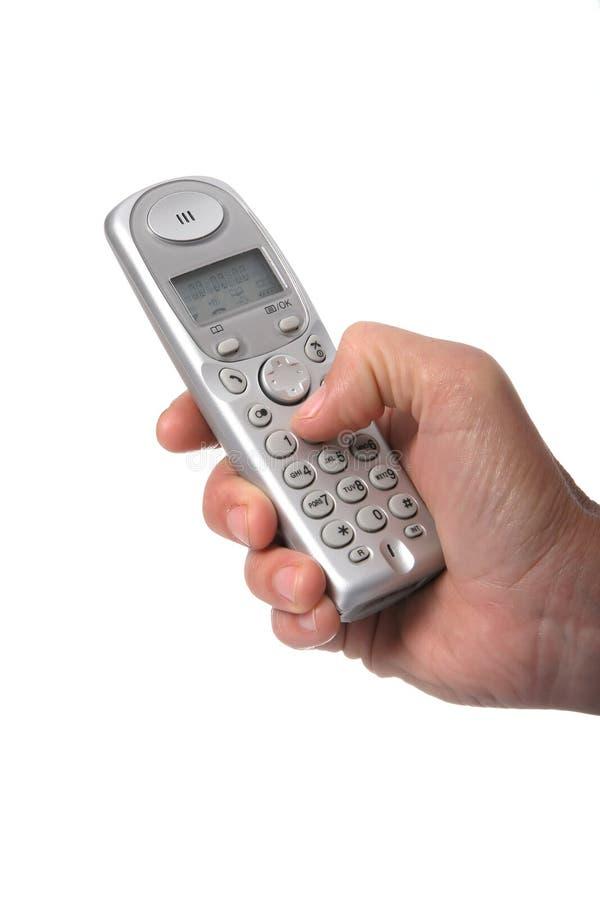 Main et téléphone image stock