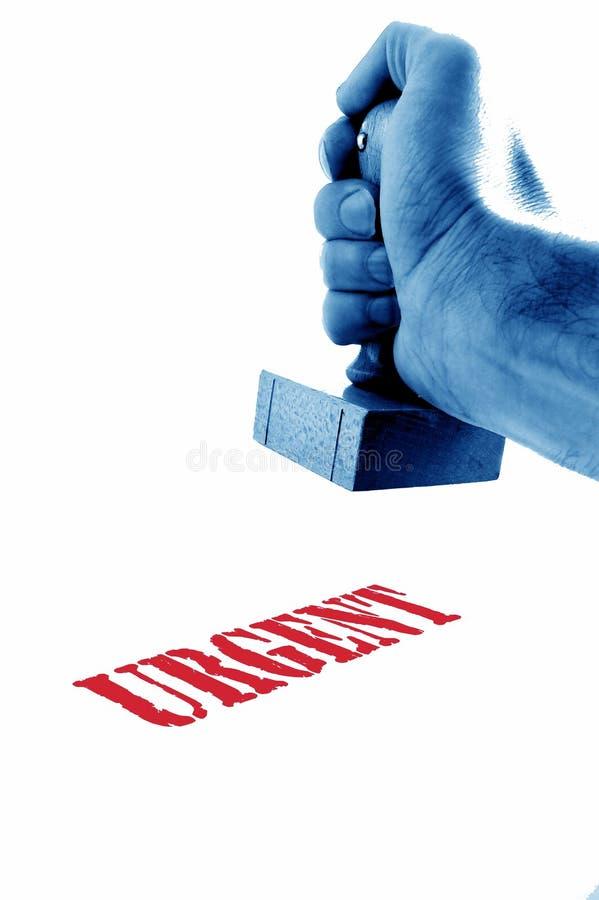 Main et tampon en caoutchouc image libre de droits