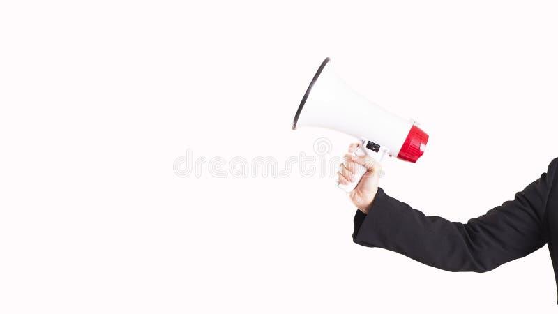 Main et un mégaphone d'isolement photographie stock libre de droits