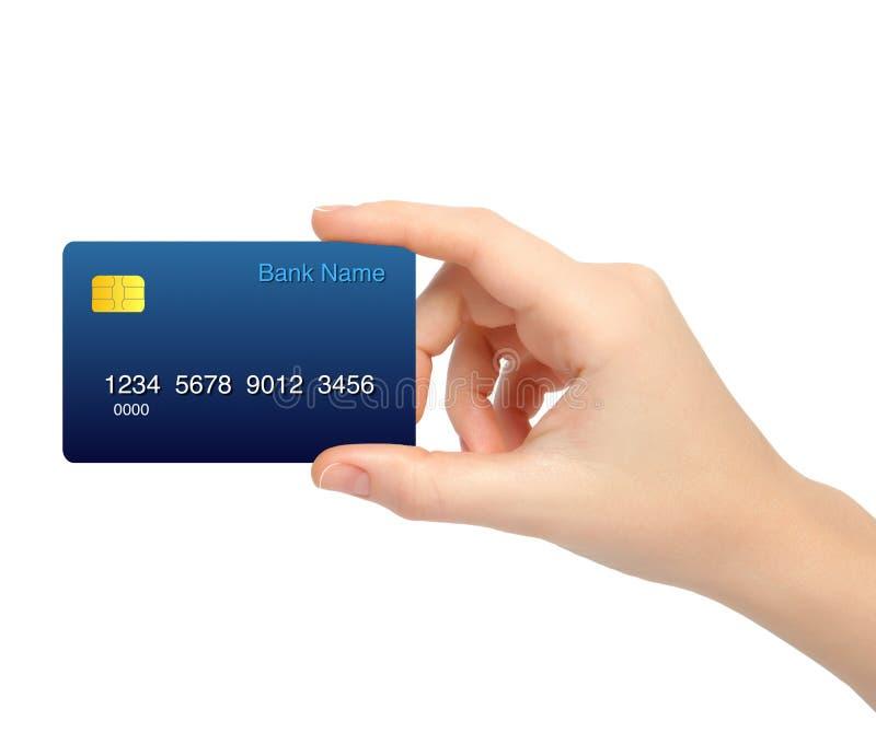 Main femelle d'isolement tenant une carte de crédit photos stock