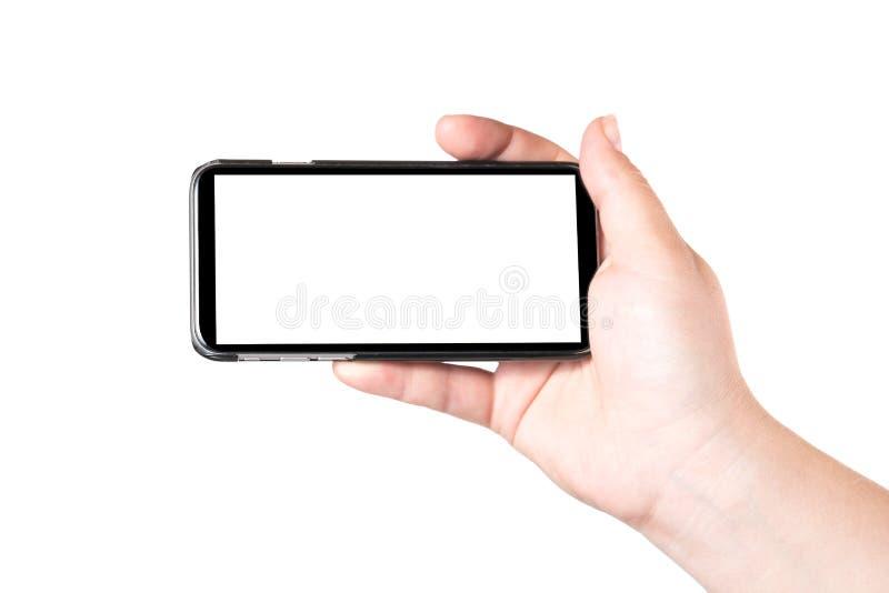 Main femelle jugeant le téléphone intelligent mobile d'isolement sur le fond blanc Écran blanc vide Concept de selfie faisant la  photos libres de droits