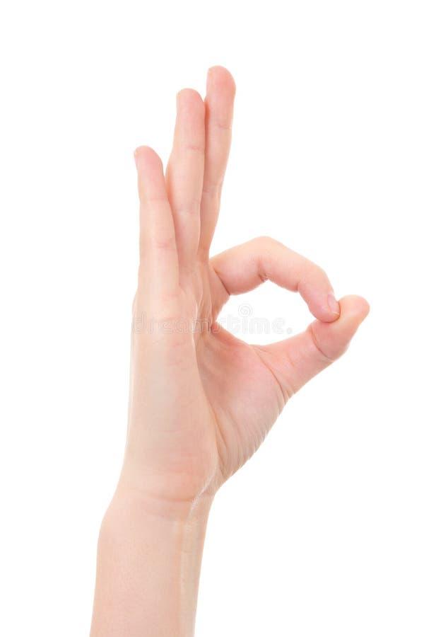 Main femelle montrant le signe correct d'isolement sur le blanc photographie stock libre de droits