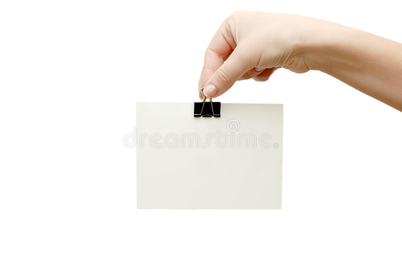 Main femelle retenant une carte photos stock