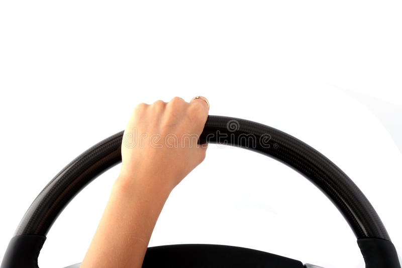 Main femelle sur un volant images libres de droits
