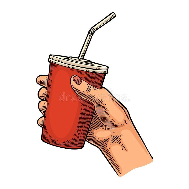 Main femelle tenant le kola rouge de papier de tasse avec des pailles, chapeau illustration stock