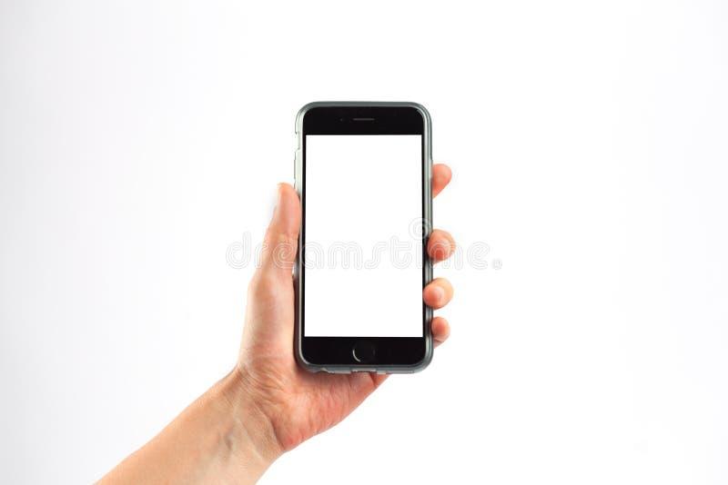 Main femelle tenant un téléphone portable verticalement photo libre de droits