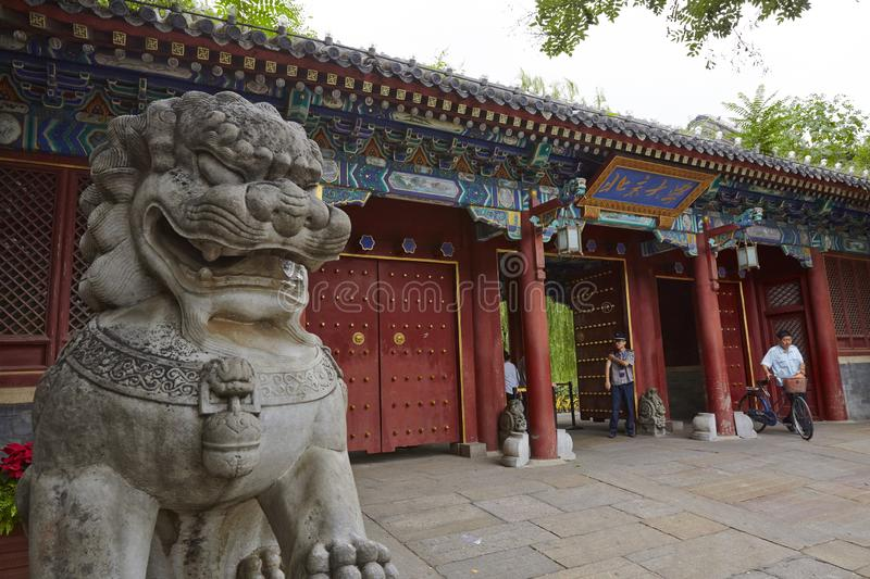 Beijing University, China. Main gate with a stone lion in traditional building style of Beijing University, one of the top famous universities in China stock photos